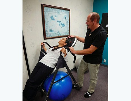 Dr. Wruck helping a patient through therapeutic exercise